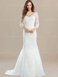 Vintage inspired wedding dress is extremely elegant! Dreamy belt at empire waist adds right amount of detail.