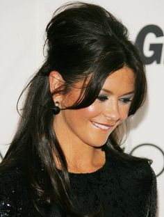 Catherine Zeta-Jones. This article says pulling hair up does not slenderize face and you have to leave pieces on face to drawn attention to eyes