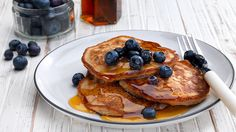 Time to drool. You can finally learn how to make pancakes from scratch. Start the day with a dairy-free Banana Pancakes with Blueberries & Maple Syrup recipe.