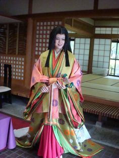 A woman dressed in  junihitoe at a museum dedicated to Murasaki Shikibu and the Tale of Genji