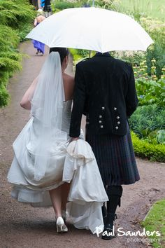 Who cares if it's raining? A bride and groom during their recent Edinburgh Wedding - Photography by Paul Saunders.