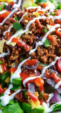 Taco Salad Recipe ~ A salad inspired by the flavours of tacos including seasoned ground beef, lettuce, tomatoes, beans, corn, salsa, cheese and crunchy tortilla chips.