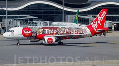 AirAsia (MY) Airbus A320-216 9M-AHE aircraft, painted in ''Tune Talk'' special colours Nov. 2013 - Dec. 2016, (1st version), with the stickers ''Tune Talk-Mixed Martial Arts Fighting Championship MALAYSIAN INVASION-Mobile Prepaid & This is Prepaid !'' on the airframe, skating at Singapore Changi International Airport. 18/05/2014. (Tune Talk=the best mobole prepaid in Malaysia).