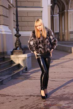 Nicole wears supertight black designer PVC leggings and black high-heels.