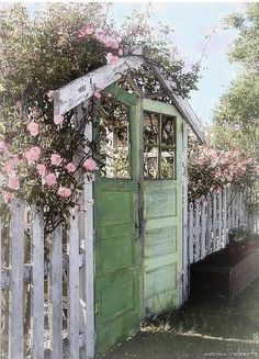 """My fantasy garden entrance or backdrop!!! I LOVE this and will keep my eyes peeled for some old doors! This one's going on the """"honey-do"""" list!!!"""