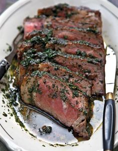 A thick, well-marbled cut—a rib eye, strip, or porterhouse—works best for this olive oil- and herb-topped steak. The dish is based on one served by the Italian-born chef Cesare Casella at Salumeria Rosi in New York City.