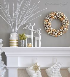 Contemporary Styling: mantel with branches and wreath all i golds and whites.