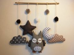 DIY Mobile with tree branch, twine, a few pompoms, felt or fabric and some stuffing.