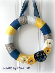 Modern Yarn Wreath in Blue, Mustard Yellow, Gray, and Brown with zipper flower and fabric flowers. via Etsy.