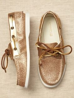 Gold sparkly sperrys.