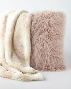 "Faux-Fur Throw & Pillow Throw and pillow sold separately. Made of acrylic faux-fur. Machine wash; fluff dry. Throw lined with incredibly soft polyester velvet. Size varies; approximately 55""–60"" x 75"". Pillow has removable zipped cover and polyester insert. 24""Sq. Imported."