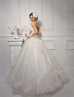 Strapless Heavily Embellished Bodice Bridal Ball Gown\Are you the girliest girl in your class, do you like all things make you more girly. Here is the perfect Cinderella looking bridal gown for you! Dream come true with this stunning gown!