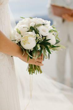 Photography: Anna Roussos Photography - annaroussos.com Read More: http://www.stylemepretty.com/destination-weddings/2014/08/13/romantic-white-santorini-wedding/