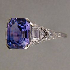 Extremely rare platinum Art Deco Asscher cut Violet blue 5.5 carat sapphire ring flanked by emerald cut diamonds by Tiffany, circa 1920.