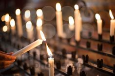 Woman lighting prayer candle - royalty free photos by franky242 photography - buy and download this photo online