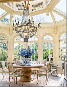 Houston home designed in 1930 by the renowned architect John F. Staub The conservatory was added onto the house – it's where the family eats breakfast.