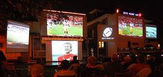 "To give our backyard the feel of an outdoor sports bar for our annual ""Guys Night Out"" party, we connect 8 projectors to 8 HD cable boxes so that we can project different live sporting events on 8 separate screens. (Six of the eight screens are shown in the attached photo, the other two wouldn't fit in the photo.)"