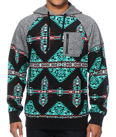 Keep your style on point with a teal, black, and red woven tribal print body with speckled grey raglan sleeves and a left zipper pocket.