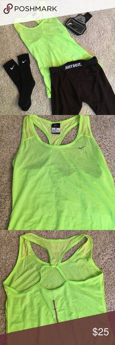 NEW Nike Dri-Fit Tank Workout Top New never worn but tags are removed! Neon yellow lime green with some silver reflective marks. Dri Fit racer back tank top. Mesh breathable material. Stretchy and very comfy! Offers and questions welcome. Bundle and save!! Nike Tops Tank Tops