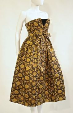 FC0006 Dress shown without jacket, gold and black woven silk, labelled Christian Dior Paris, from the autumn 1958 collection, acquired from Loi Hathaway, the second owner of the dress who altered it slightly, restoration undertaken by Bret Fowler, courtesy of the Josef Wosk fund, to return dress to original condition