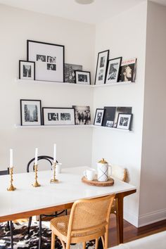 Our picture wall is finally complete! Today, I'm sharing a DIY dining nook photo ledge. I can't believe how much homier the whole room looks now. Ikea Picture Ledge, Picture Wall, Photo Ledge Display, Photo Shelf, Feng Shui Tips, Kitchen Nook, Corner Dining Nook, Room Pictures, Dream Decor