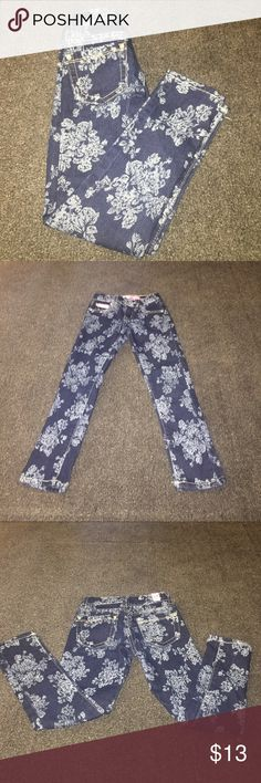 Beautiful Floral Patterned Jeans Girls 5T Beautiful jeans size 5T navy blue and white pattern with flowers. Rhinestones on the buttons. Skinny jeans says size 6 but fits a 5T. Never worn new without tags Pink latte Bottoms Jeans