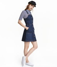 Denim dungaree dress Denim dungaree dress: Short dungaree dress in washed stretch denim with buttons down the front, adjustable straps, a seam at the waist and side pockets. Denim Pullover, Denim Jumper Dress, Denim Dungarees, Jeans Dress, Overalls, Denim Dress Pinafore, Denim Dungaree Dress Outfit, Denim Outfits, Skirt Outfits