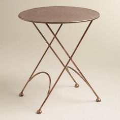 One of my favorite discoveries at WorldMarket.com: Round Ariana Metal Accent Table 80.00