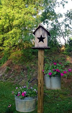 Pretty yard idea using old buckets.