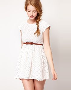 White lace dress, bow belt, and messy side braid.