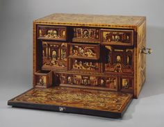 Cabinet with a Depiction of Architectural Landscapes  Germany Late 16th century wood and bronze Dimension: 35x54x31 cm