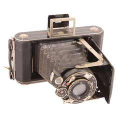 Vintage Kodak 620 Camera - collectible camera with expendable lens that closes up in protective casing. Decorative purposes only.
