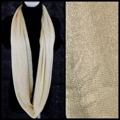"B45 Metallic Glitter Ivory Lurex Infinity Scarf Metallic Lurex Infinity Scarf   Photos do not do justice to this scarf (probably my poor photography skills).  It is really gorgeous & versatile.  Beige with metallic threading. 100% viscose. 25"" wide, 33"" long.  Please check my closet for many more items!  ‼️ PRICE FIRM UNLESS BUNDLED WITH OTHER ITEMS FROM MY CLOSET ‼️ Boutique Accessories Scarves & Wraps"