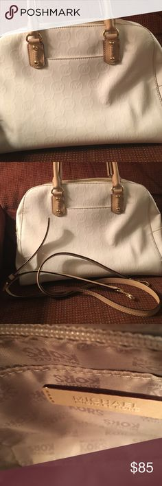 Michael kors satchel Michael lord patent leather white purse and cross body very lightly used condition . Interior and handles show no wear . Cross body strap never used very lightly used condition. Michael Kors Bags Satchels