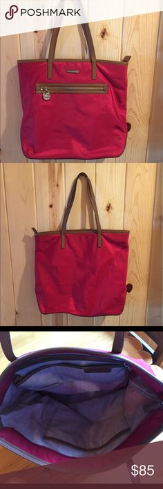 MICHAEL KORS Large Bag, Cherry Red MICHAEL KORS large cherry red tote in excellent condition! Front zip pocket. Nylon and leather. Top zip closure. Golden hardware. Two handles with 10 inch drop. Interior features one zipper pocket and four open pockets, plus key clip. Michael Kors Bags Totes