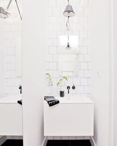 A 27-inch floating vanity and an articulating sconce are excellent space savers in the tiny bathroom.   Image: Janis Nicolay   #SmallSpace #Bathroom #SubwayTile #StyleAtHome