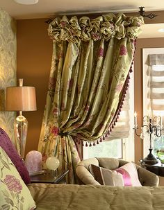 Master bedroom sitting area vignette is ensconced with silk draperies.