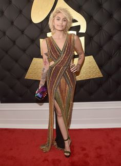 Paris Jackson - Wore a richly multi-hued Balmain Spring 2017 cut-out gown adding a bit of electric colour via a holographic Kotur clutch. Jewels (Kimberly McDonald), Hair (John D Forward Artists) Makeup (Jo Baker) (Image) | The 59th GRAMMY Awards, STAPLES Center, Los Angeles, CA 12 Feb 2017