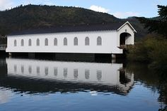 The Lowell covered bridge built over Dexter Lake in Oregon~