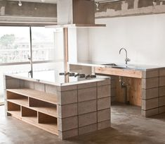Sophisticated use of concrete block, stainless steel and plywood in House K by TANK