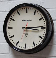 Magnificent deep rimmed 1960s Vintage Bakelite Industrial Wall Clock by Pragotron, Czechoslovakia. This was a 'slave' clock which would have been a factory or school. It has been converted to battery and now in full working order.