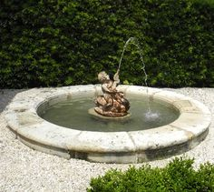 This 18th c. stone basin, accented by an iron fountain center, originally graced the garden of a property in Aix-en-Provence, France.