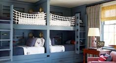 This nautical-inspired bunk room in a Hamptons home by Steven Gambrel features lots of room for storage with built-ins and under-bed drawers. Custom netting provides safety for the top bunks. Double Bunk Beds, Bunk Beds Built In, Twin Beds, Built In Beds For Kids, Double Twin, Cool Boys Room, Boy Room, Child's Room, Alcove Bed