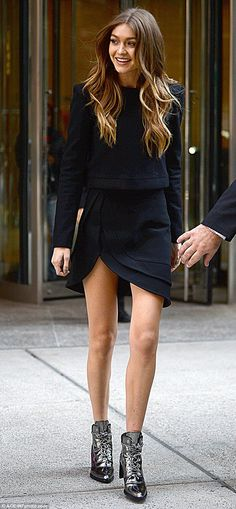 Stylish in silver: Gigi Hadid, 21, hit the streets of New York City in boots from her capsule collection with Stuart Weitzman and a sleek shirt and skirt by Brandon Maxwell