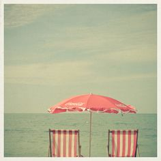 I want to relax by the beach reclining in retro beach chairs under a pink umbrella for an entire day - only getting up to take a dip in the ocean.