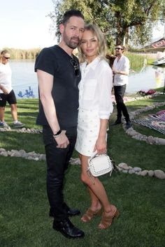 Michael Polish and Kate Bosworth on the first day of Coachella. Click on the image to read more.