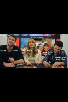Haha Liam Hemsworth, Jennifer Lawrence, and Josh Hutcherson signing autographs.