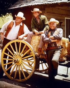 Dan Blocker, Michael Landon, and Lorne Greene happily pose against a stack of hay bales, circa summer 1966  Photo credit:  Courtesy of Silver Screen Collection / Getty Images