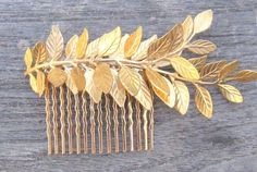 Hey, I found this really awesome Etsy listing at http://www.etsy.com/listing/59787294/double-gold-leaf-comb