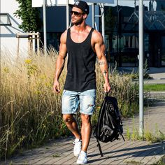 Tank Top with denim shorts , Sunglasses & a cap with leather bag. #TheUnstitchd